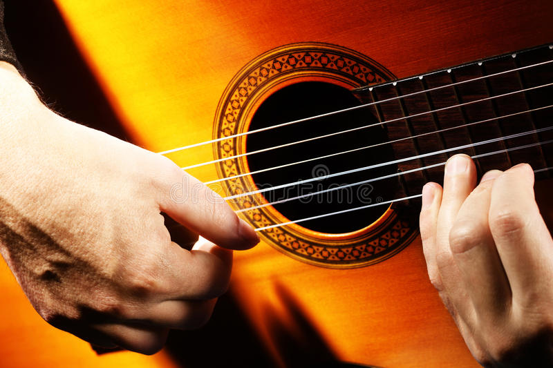 Acoustic guitar strings hands stock image