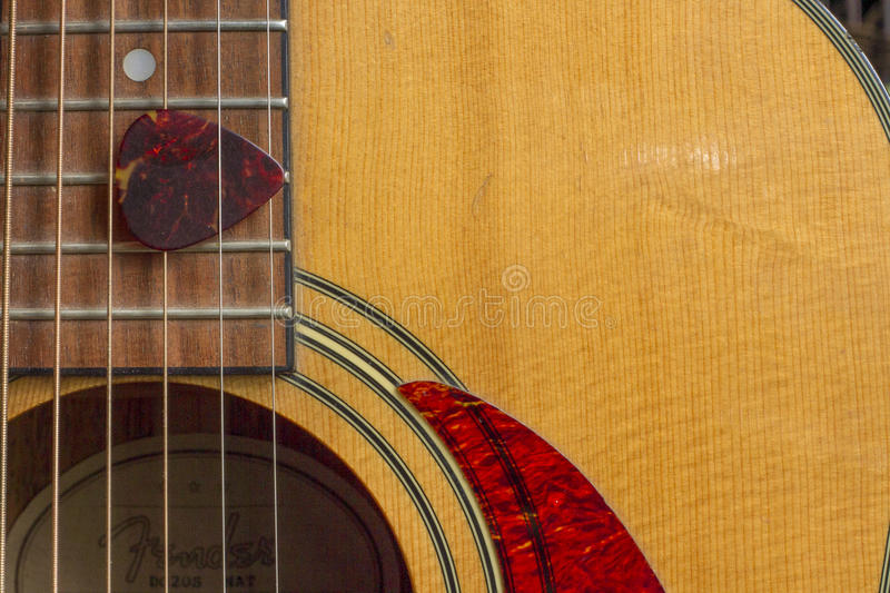 Acoustic Guitar Sound Hole and Pick royalty free stock photography