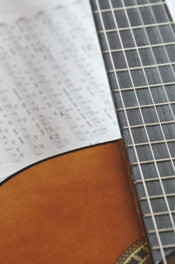 Acoustic guitar with tablature royalty free stock image