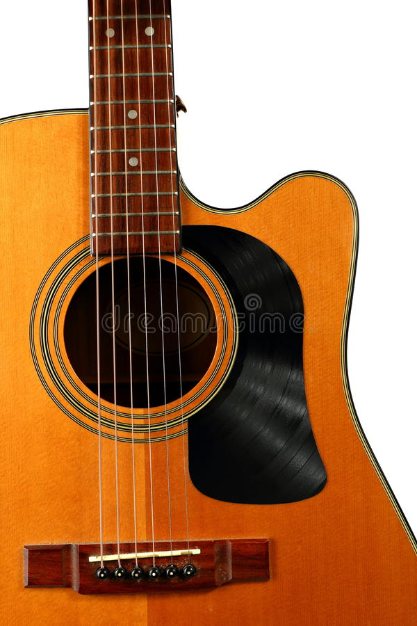 Acoustic Guitar with Vinyl Record for a Pick Guard. An acoustic guitar is shown with a pick guard made from a vinyl record stock photos