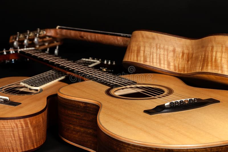 Acoustic guitars. Hand-made wooden classical and folk music inst royalty free stock images