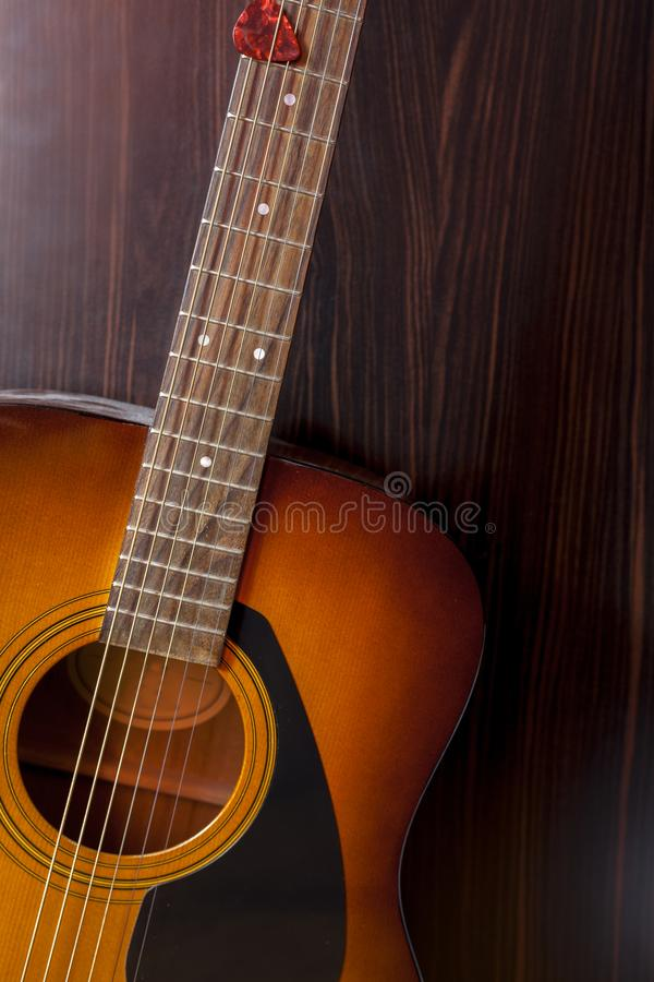 Acoustic wooden guitar stock image