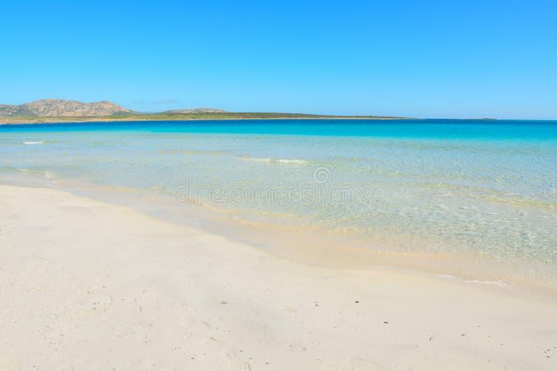 Acqua bianca del turchese e della sabbia immagini stock