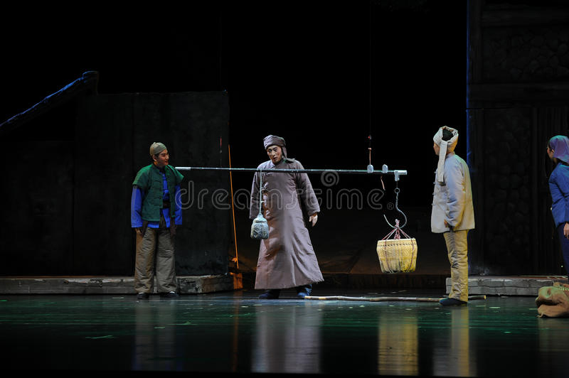 Acquisition of food- Jiangxi opera a steelyard. Jiangxi opera a steelyard is adapted from a true story: the last century fortys, the protagonists father runs an stock photography