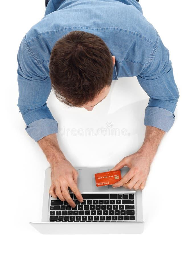 Acquistando con la carta di credito fotografie stock
