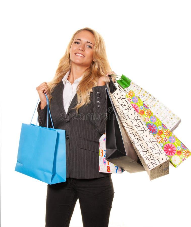 Acquisto della donna con molti sacchetti di acquisto fotografia stock libera da diritti