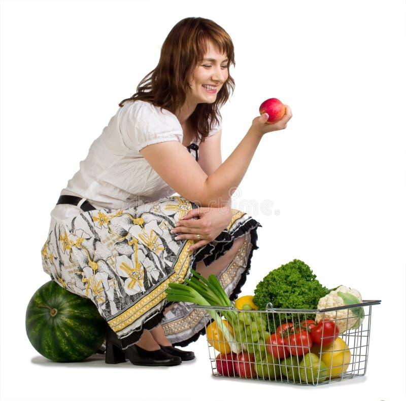 Acquisto della donna per le verdure fotografia stock