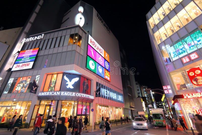 Acquisto di notte di Tokyo immagini stock libere da diritti