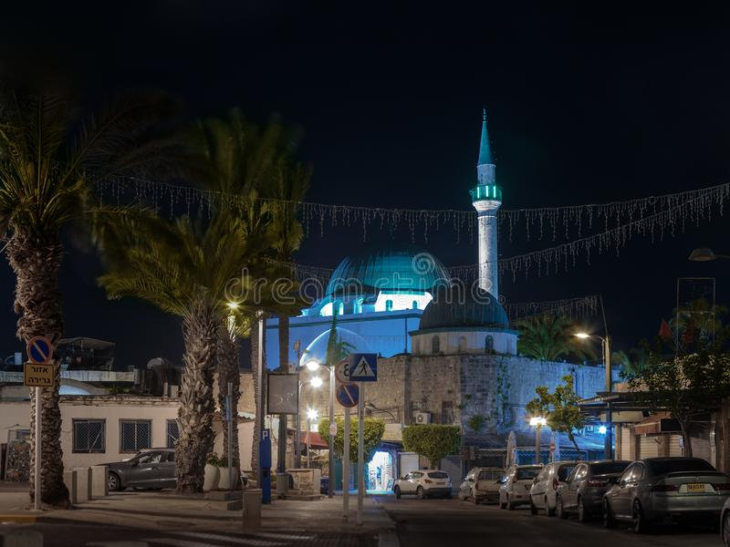 Night view of Weizman street and the Al-Jazzar Mosque in the old city of Akko in Israel royalty free stock photos