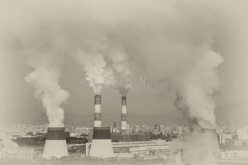 The acrid thick industrial smoke. pipe smoke. Atmospheric emission stock photography