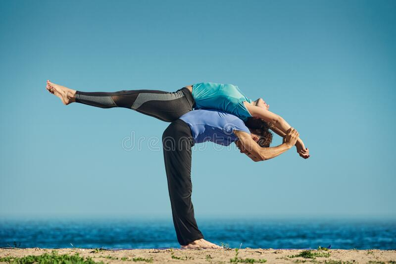 Acro yoga in pair stock photography