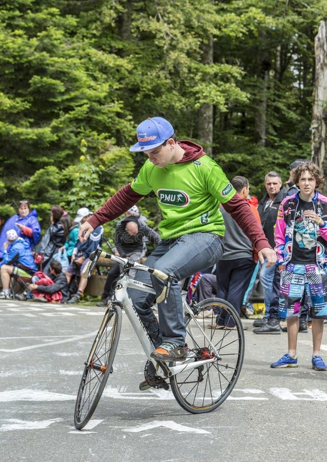 Acrobat Amateur Cyclist - Tour de Freance 2014 stock photography