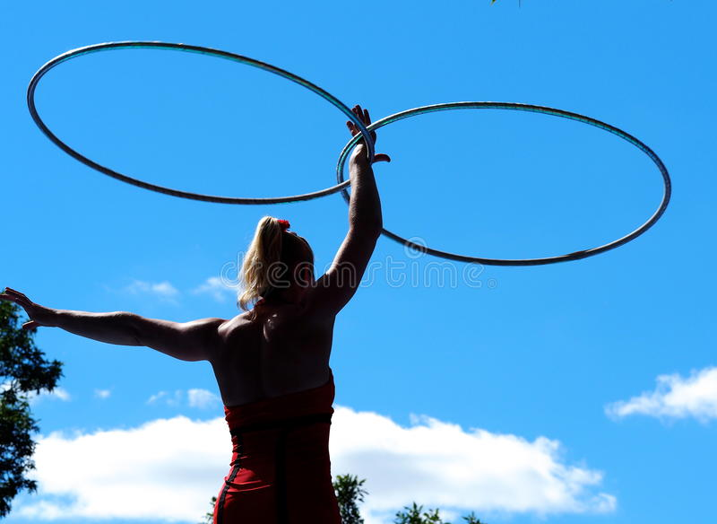 Acrobat At Edmonton Fringe Festival. Acrobat with hula hoops at the Edmonton Festival August 21, 2015 stock photos