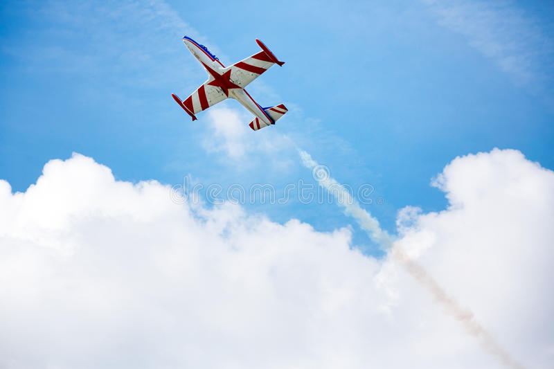 Acrobat in movement of air show. Airplane on the sky royalty free stock photo