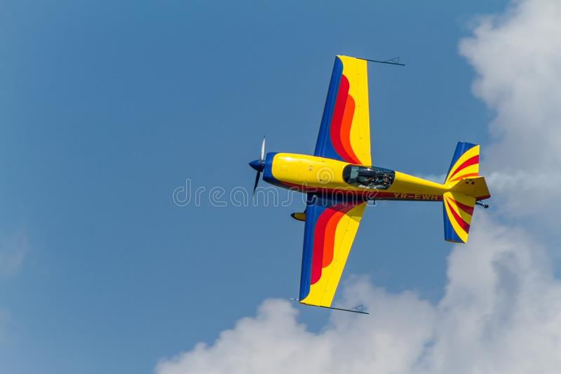 Acrobatic airplane on the sky stock images