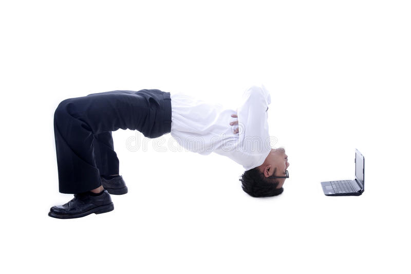 Acrobatic Asian businessman. Young asian businessman with his acrobatic moves royalty free stock photography
