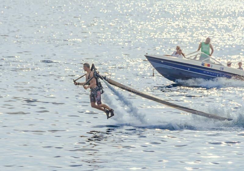 Acrobatic Jetsky pilot training on the lake. Aeronautic show.  royalty free stock photo