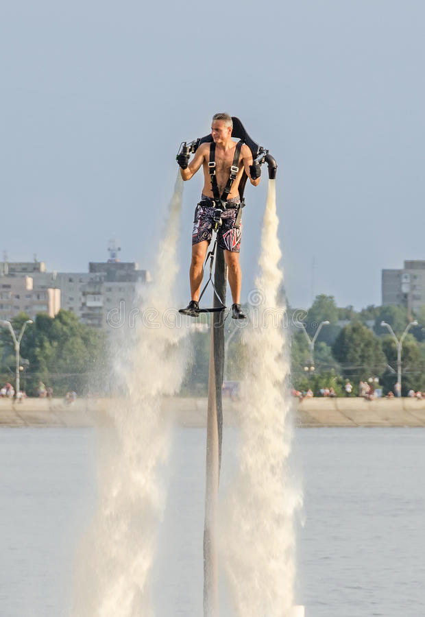 Acrobatic Jetsky pilot training on the lake. Aeronautic show.  royalty free stock photography