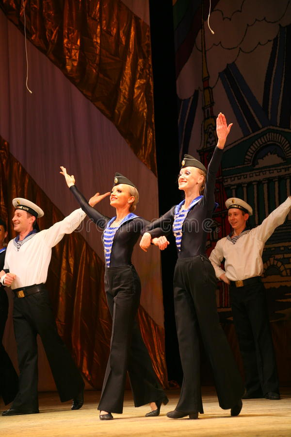 Acrobatic old traditional national Russian sailor dance Yablochko royalty free stock image