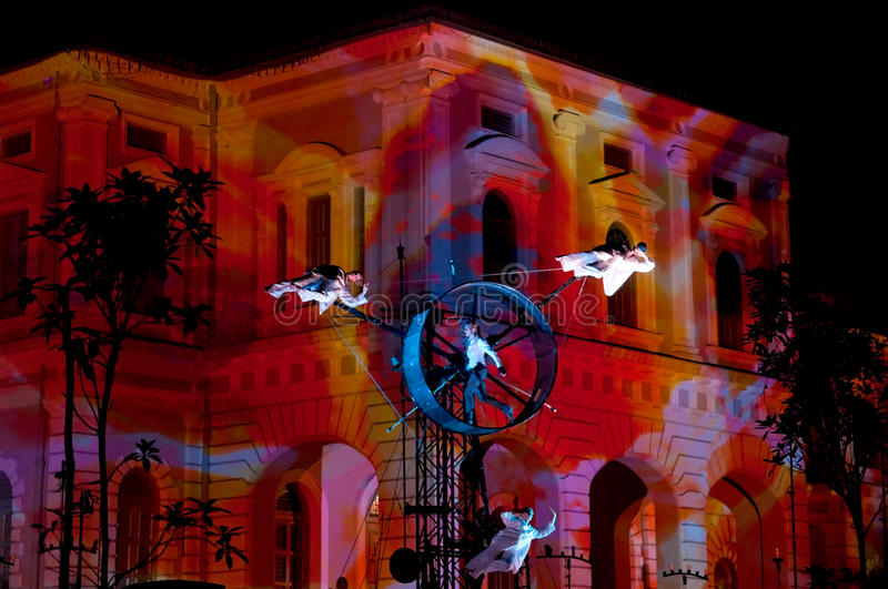 Acrobatic Performance Against Museum Backdrop stock image