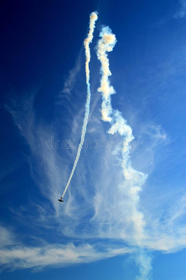 Acrobatic plane diving in the air stock photo