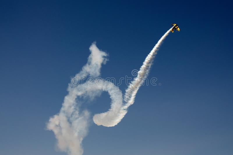 Acrobatic plane in flight stock image