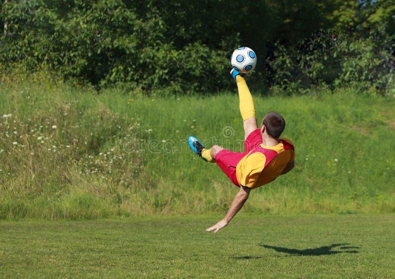 Acrobatic soccer player stock photo
