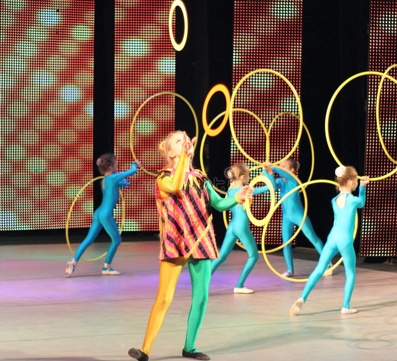 Acrobats and jugglers children. On the stage of the Palace of Children and Youth. Kiev stock image