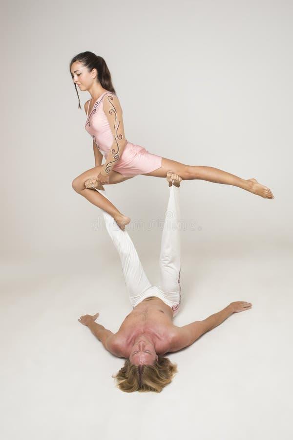 Acrobats Perform As A Team Stock Photos