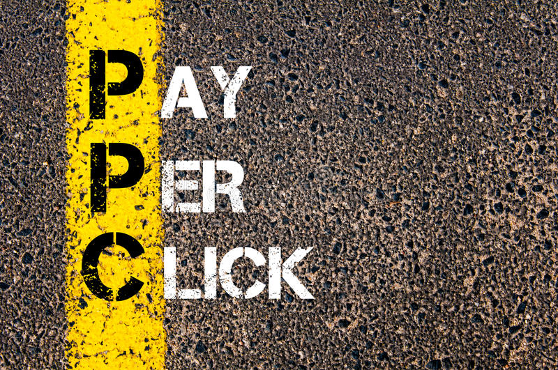Acronym PPC - Pay Per Click. Business Conceptual image with yellow paint line on the road over asphalt stone background stock photography