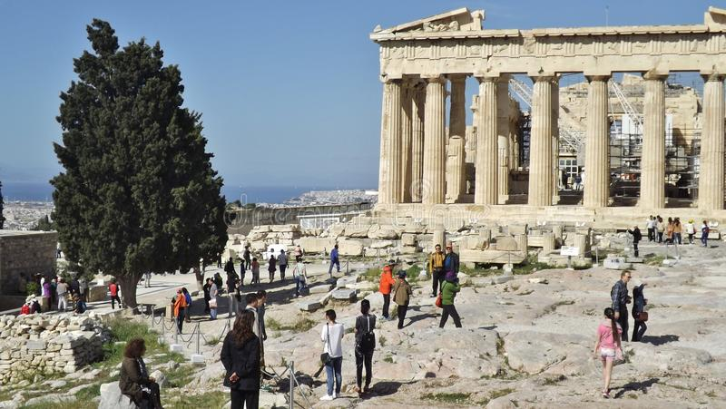 The Acropolis in Athens, Greece. ATHENS, GREECE – MAY 1, 2014. The parthenon oft he Acropolis in Athens, Greece, with the city and the sea in the stock photography
