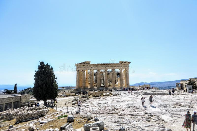 A large group of visitors admiring the Parthenon atop the Acropolis on a hot sunny day during a summer day in Athens royalty free stock images