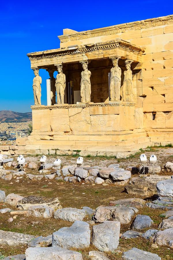 Acropolis, Erechtheum Temple in Athens, Greece. Acropolis, porch of caryatids, Erechtheum Temple in Athens, Greece and blue sky royalty free stock images