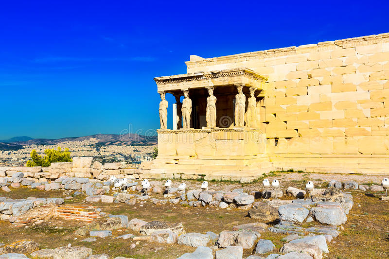 Acropolis, Erechtheum Temple in Athens, Greece. Background with Acropolis, Erechtheum Temple in Athens, Greece and blue sky stock images