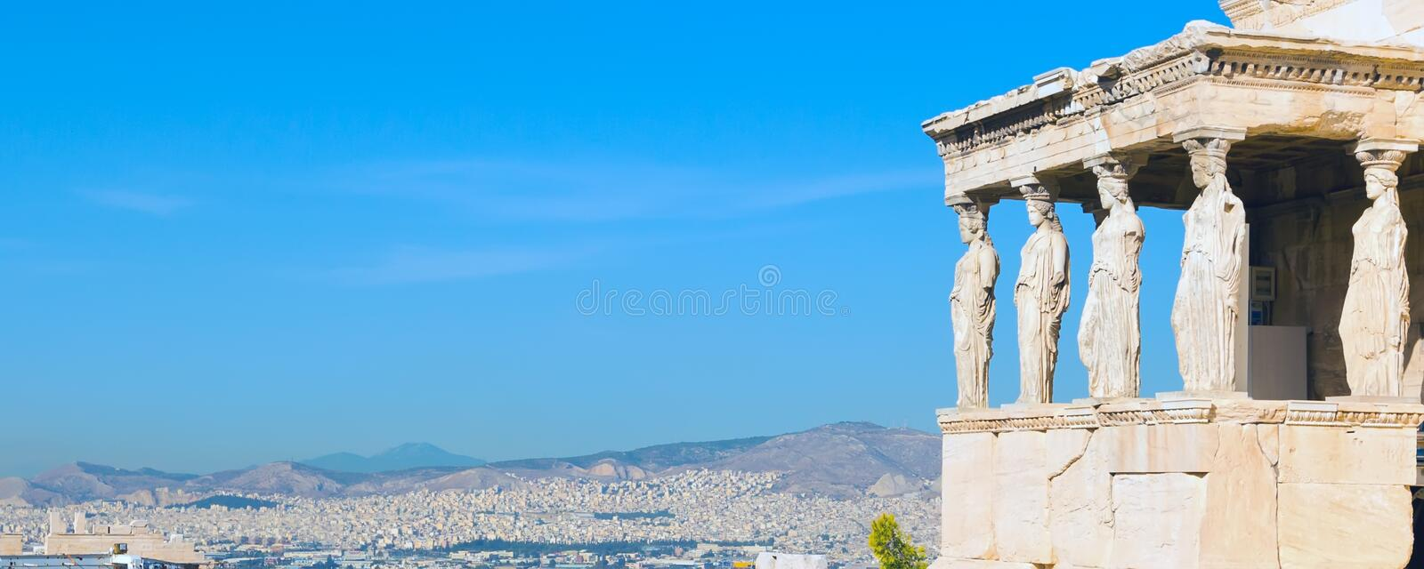 Acropolis, Erechtheum Temple in Athens, Greece. Banner panoramic background with Acropolis, Erechtheum Temple in Athens, Greece and blue sky stock photo