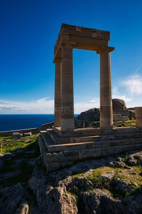 Acropolis of Lindos, Rhodes, Greece. Acropolis of Lindos, doric coloums of the ancient Temple of Athena Lindia the IV century BC, Rhodes, Greece stock photo