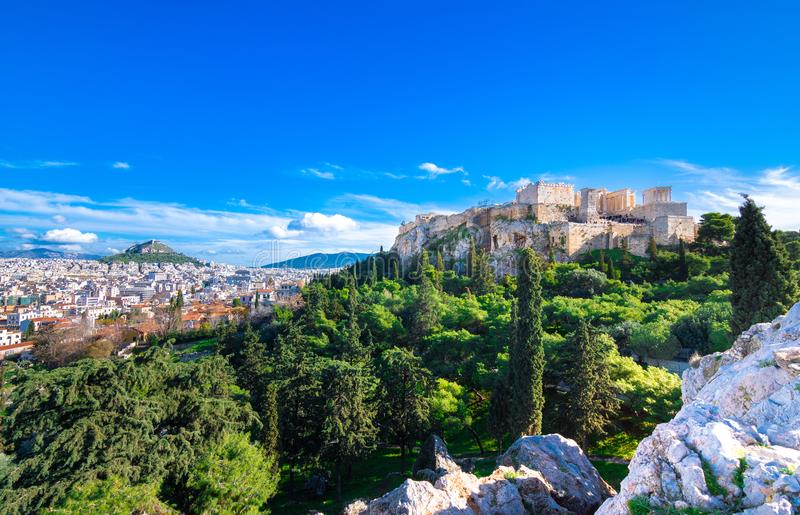 Acropolis with Parthenon. View through a frame with green plants, trees, ancient marbles and cityscape, Athens. royalty free stock images