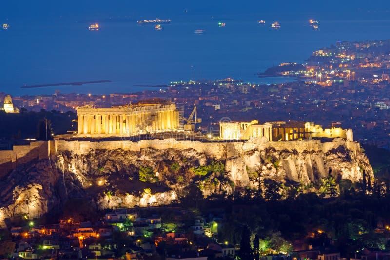 Acropolisen på natten arkivfoton