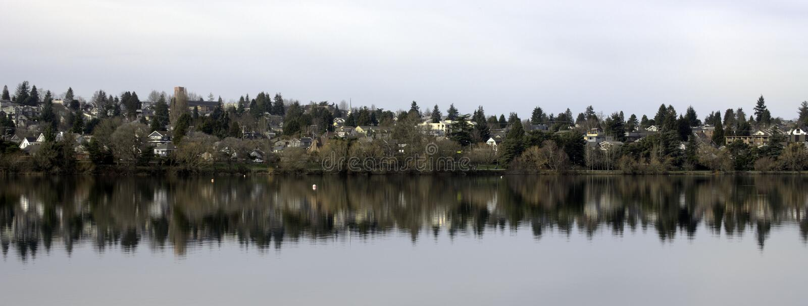 Across the Lake. A residential neighborhood reflects on Green Lake in Seattle royalty free stock images