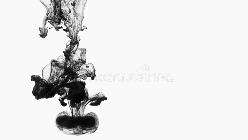 Acrylic black ink in water, isolated on white royalty free stock photos