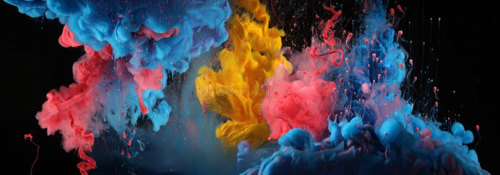 Acrylic blue and red colors in water. Ink blot. Abstract black background royalty free stock photos