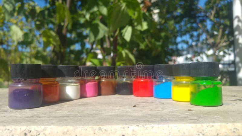 Acrylic colorful paints on stone. royalty free stock photography