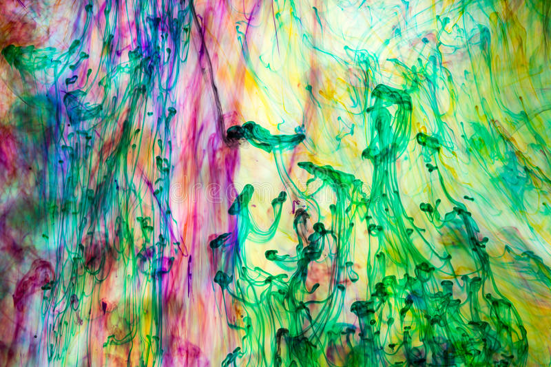 Acrylic colors and ink in water. Abstract background royalty free stock images