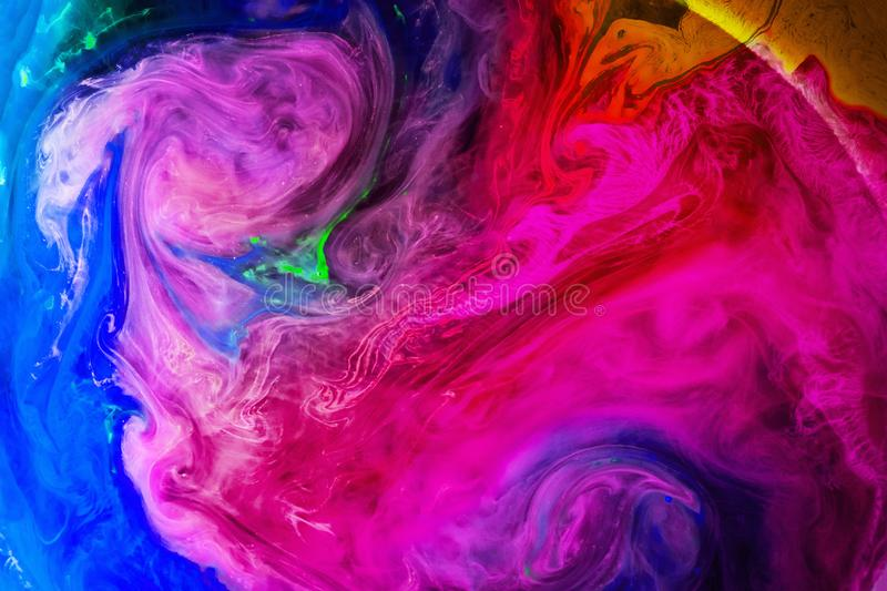 Acrylic colors and ink in water isolated multicolor background. Colorful Paint splash. Abstract background stock photography