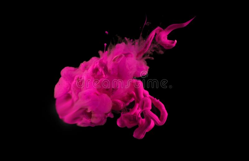 Acrylic colors in water. Abstract background. Acrylic magenta colors in water. Ink blot. Abstract background royalty free stock image