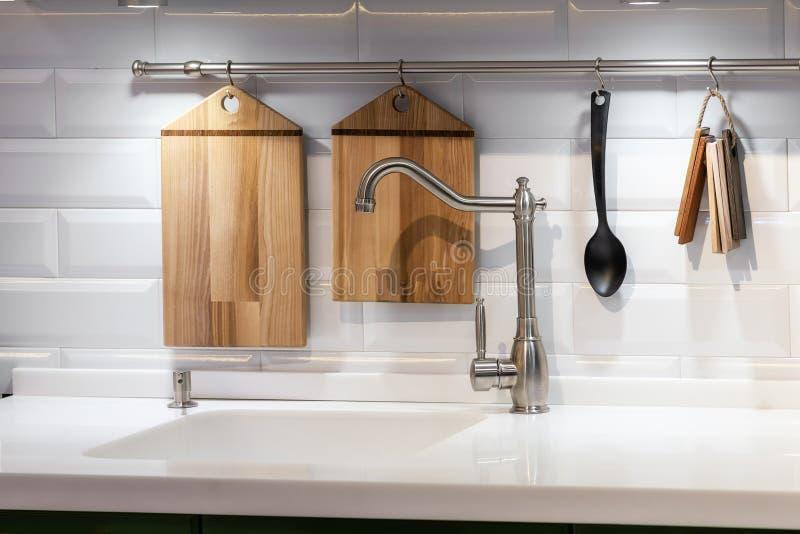 Acrylic kitchen sink built into the countertop royalty free stock photos