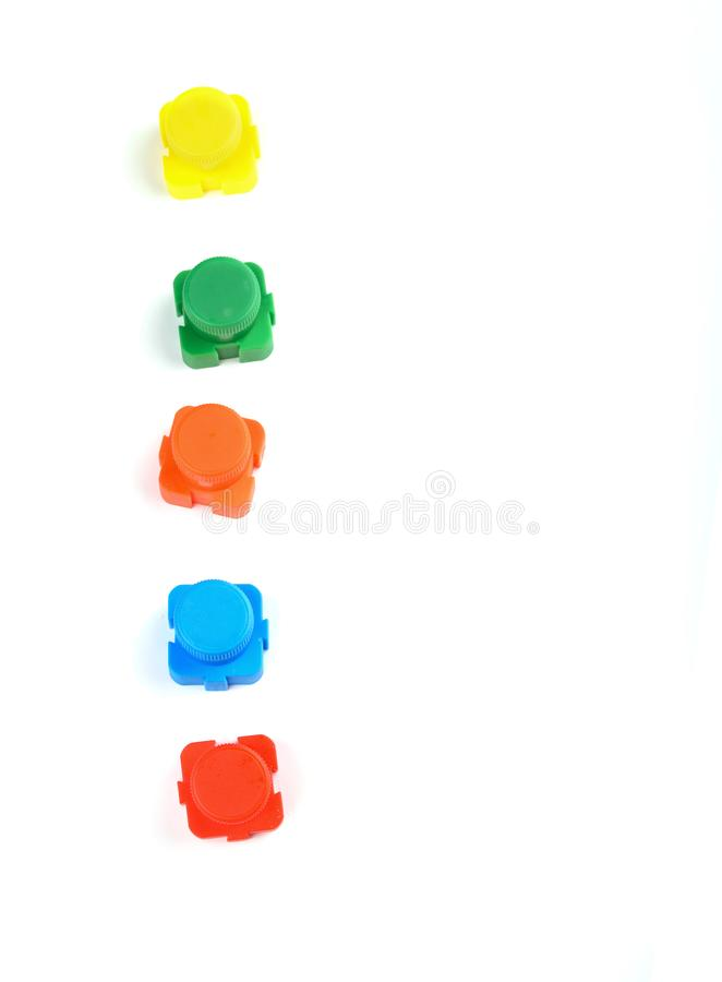 Acrylic multi-colored paint in beautiful jars on a white background stock photo