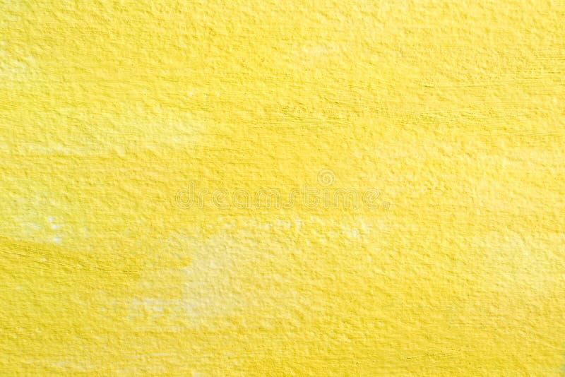 Acrylique de jaune sur la texture de papier photographie stock libre de droits