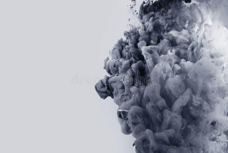 Acrylkleuren in water abstracte achtergrond stock afbeeldingen