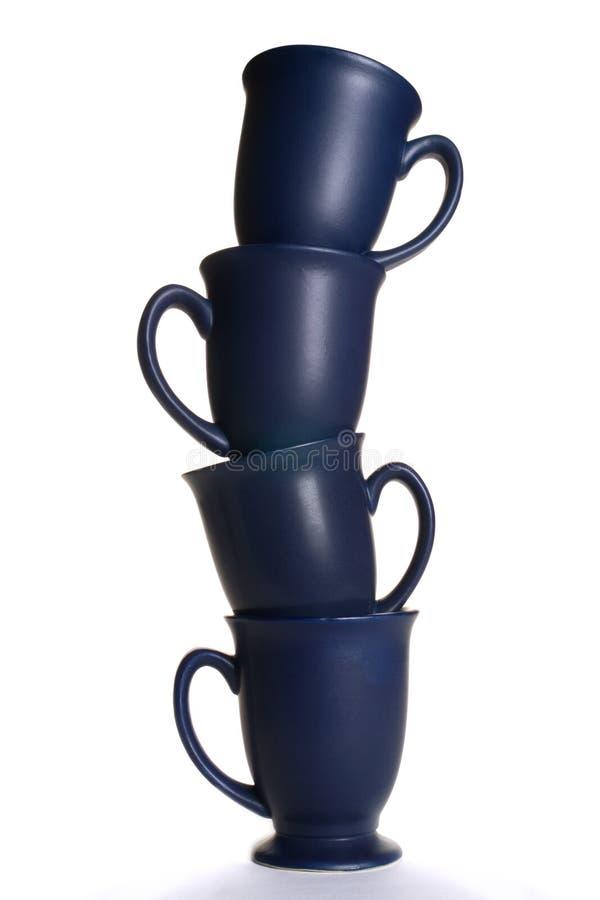 act balancing coffee mugs arkivfoto